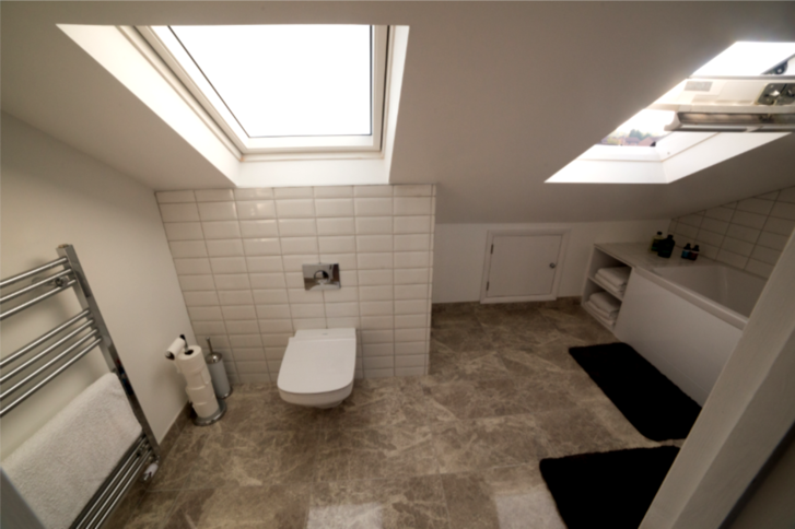 Bathroom suite in large dormer conversion in Maidenhead