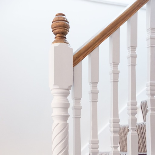 Newel posts and newels caps on traditional staircase