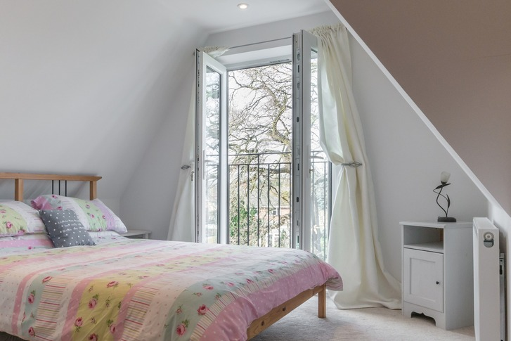 Bedroom in loft conversion with balconet